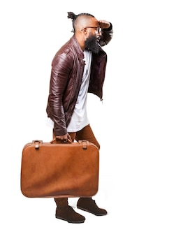 Man carrying a brown suitcase