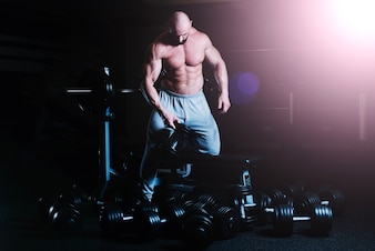 Man choosing dumbbell