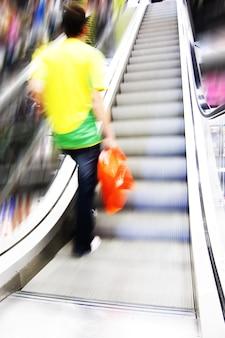 Man climbing in a escalator