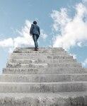 Man climbing stairs to heaven