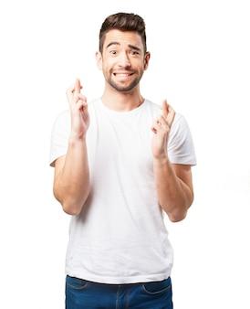 Man crossing fingers of both hands