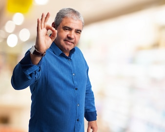 Man doing ok gesture