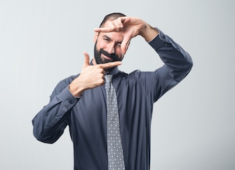 Man focusing with his fingers