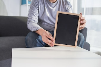Man hold with chalkboard