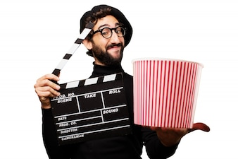 Man holding a clapper and popcorn