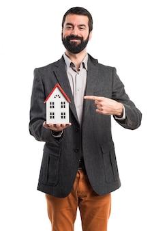 Man holding a little house