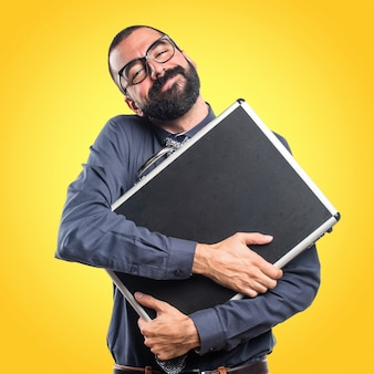 Man holding a suitcase on colorful background