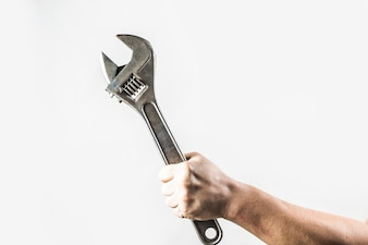 Man holding an adjustable wrench