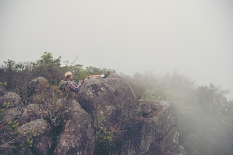 Man in a mountain with fog