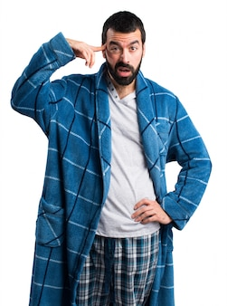 Man in dressing gown making crazy gesture