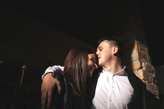 Man in love kissing his girlfriend's forehead