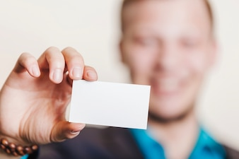 Man in suit holding visiting card