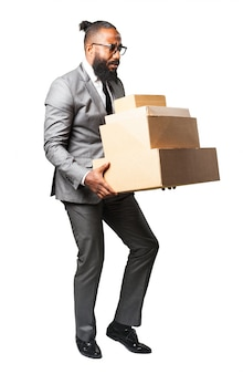 Man in suit with lots of boxes