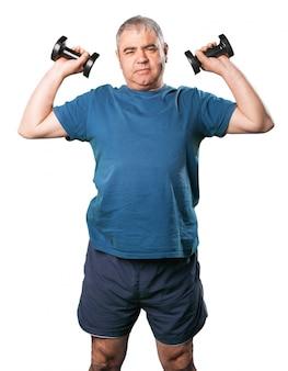 Man lifting black dumbbells
