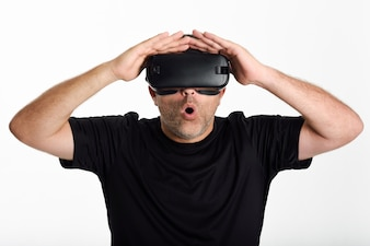 Man looking in VR glasses and gesturing with his hands.