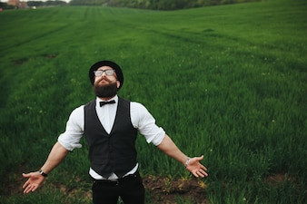 Man looking up with field background