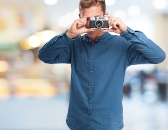 Man making a photo with an old camera