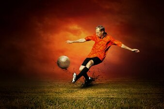 Man playing football on orange background