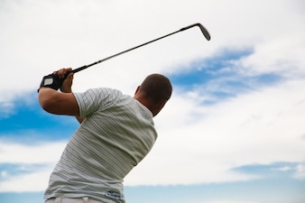 Man playing golf on his back