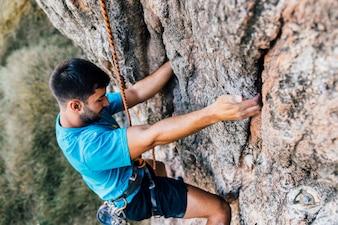 Man practicing rock climbing