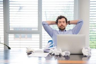 Man relaxing at working place