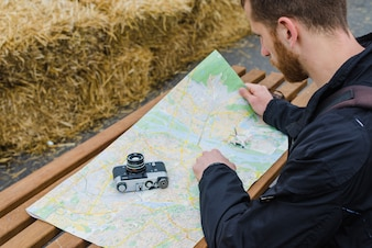 Man searching route on map