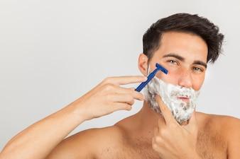 Man shaving with razor