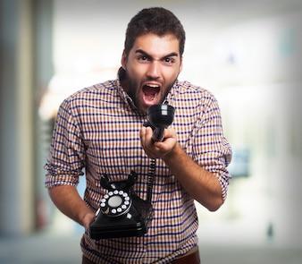 Man shouting at an old phone
