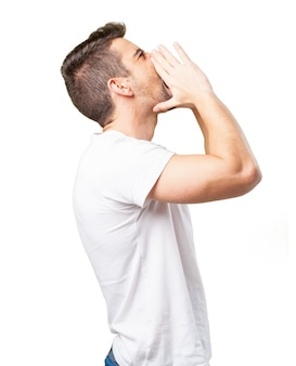 Man shouting with hands on face to one side