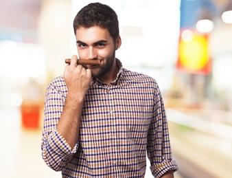 Man smelling a cigar