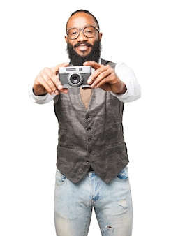 Man smiling and holding a camera