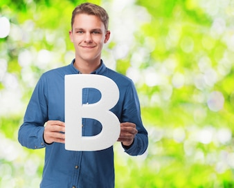Man smiling holding the letter  b
