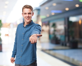 Man smiling offering his hand