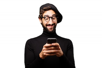 Man smiling typing on a smartphone