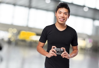 Man smiling with a photo camera