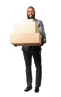 Man smiling with lots of boxes
