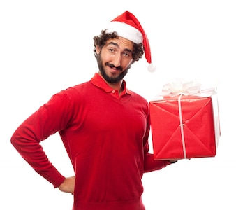 Man smiling with santa's hat and a gift