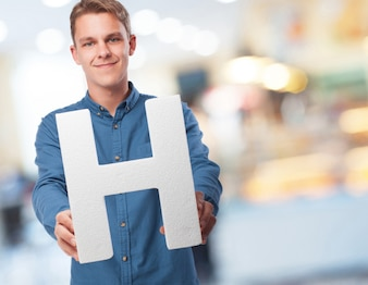 Man smiling with the letter  h