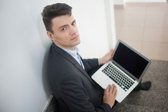 Man stairs mobile computer formal
