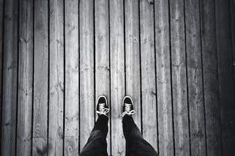 Man standing on the old wooden floor.