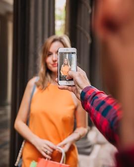 Man taking photo of girlfriend