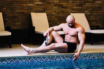 Man touching pool water
