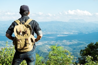 Man Traveler with backpack hiking outdoor Travel Lifestyle and Adventure concept.