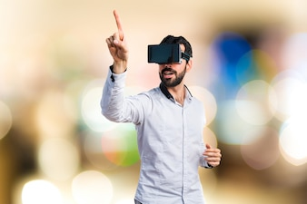 Man using VR glasses touching on transparent screen on unfocused background