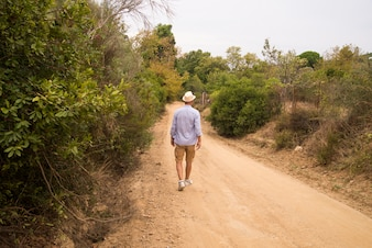 Man walking on the road with relax mood.