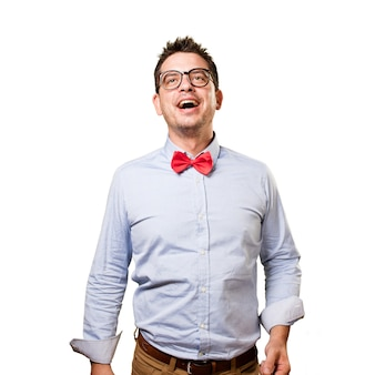 Man wearing a red bow tie. Looking happy.