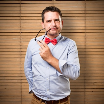 Man wearing a red bow tie. Looking sexy.