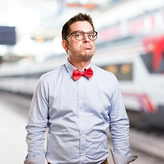 Man wearing a red bow tie. Looking tired.