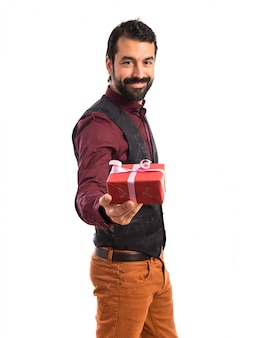 Man wearing waistcoat holding a gift