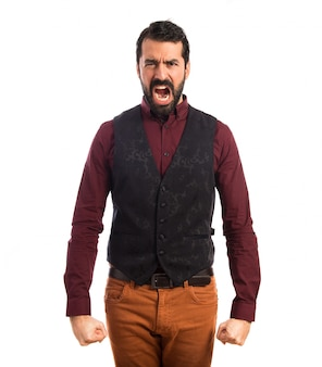 Man wearing waistcoat shouting